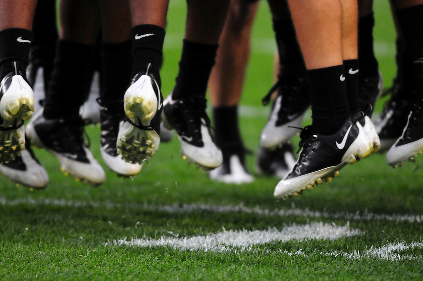 18 September 08: Players jump in unison prior to the start of a game between Colorado and West Virginia. The Colorado Buffaloes defeated the West Virginia Mountaineers 17-14 in overtime at Folsom Field in Boulder, Colorado. For Editorial Use Only.