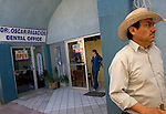 ALGODONES, MEXICO-MARCH 22: A dental technician leaves work at the end of the afternoon March 22, 2005 in Algdones. A booming cross border business has attracted more than 200 dentists to the town. Wages for employees are higher than elsewhere in Mexico.©Radhika Chalasani