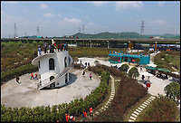 BNPS.co.uk (01202 558833)<br /> Pic: AdrianFisherDesignLtd/BNPS<br /> <br /> A-mazing record...<br /> <br /> A British company has set two Guinness world records by creating the largest hedge maze on the planet.<br /> <br /> The Maze of the Butterfly Lovers now holds the records for the largest hedge maze by area at 8.29 acres - equivalent to four football pitches - and the maze with the greatest length of paths at 5.2 miles.<br /> <br /> The impressive attraction in Ningbo in China was created by Adrian Fisher Design Ltd of Durweston, Dorset, and cost &pound;1m.