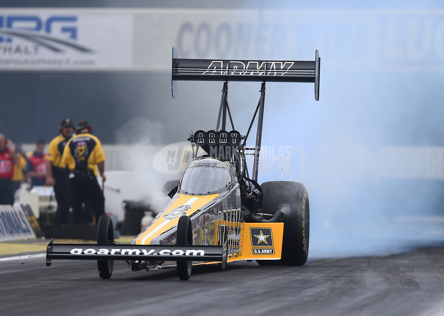 Feb 10, 2017; Pomona, CA, USA; NHRA top fuel driver Tony Schumacher during qualifying for the Winternationals at Auto Club Raceway at Pomona. Mandatory Credit: Mark J. Rebilas-USA TODAY Sports