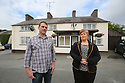 TO GO WITH IAN COBAIN FEATURE - JOB BOOKED BY GUY LANE:  Aidan O'Toole a  survivor of the 1994 gun attack, and Emma Rogan the daughter of Adrian Rogan a victim who was murdered by Loyalist gunmen in 1994 attack stands outside the Bar, as it is today. (2 Oct 2012). O'Tooles Bar is the only Pub in the small village of Loughinisland in County Down, Northern Ireland. On 18 June 1994 and The Ulster Volunteer Force (UVF), a loyalist paramilitary group, attacked the crowded pub with assault rifles killing six civilians and wounding five. The pub was targeted because those inside were believed to be Catholics. Photo/Paul McErlane