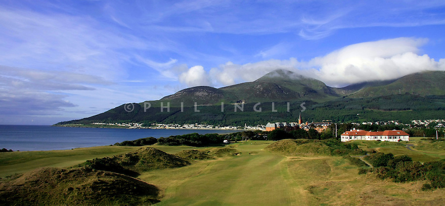 A view of the 9th hole with the backdrop of the Mountains of Mourne. The links stretches along the shores of Dundrum Bay, zigzagging back and forth to providea different vista from nearly every hole
