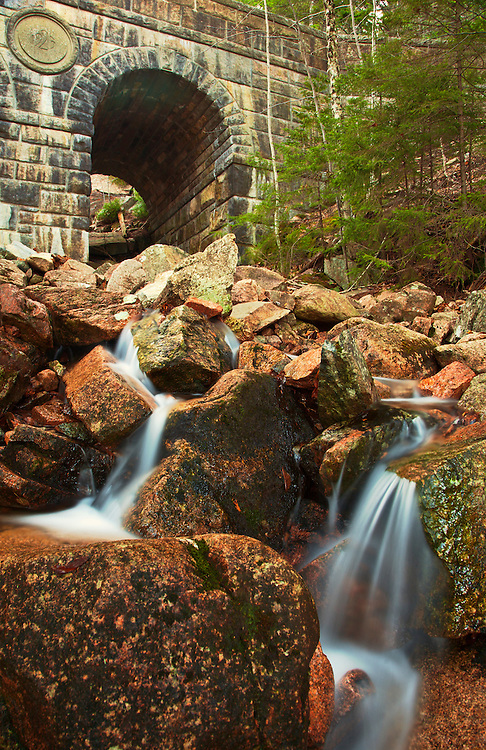 Deer Brook cascades beneath the historic Deer Brook Bridge in Acadia National Park, Mount Desert Island; Maine, USA