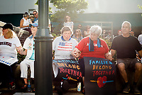 NWA Democrat-Gazette/CHARLIE KAIJO Attendees hold hands for a prayer during a rally, Saturday, June 30, 2018 at the downtown square in Fayetteville. <br /> <br /> The rally in Fayetteville is one of hundreds of rallies planned as part of a Families Belong Together national day of action to protest the administration&rsquo;s &ldquo;zero tolerance&rdquo; immigration policy, which remains in effect. Advocacy groups such as MoveOn, the Human Rights Campaign and the American Civil Liberties Union have joined in, and at least 130 rallies in 48 states are planned.
