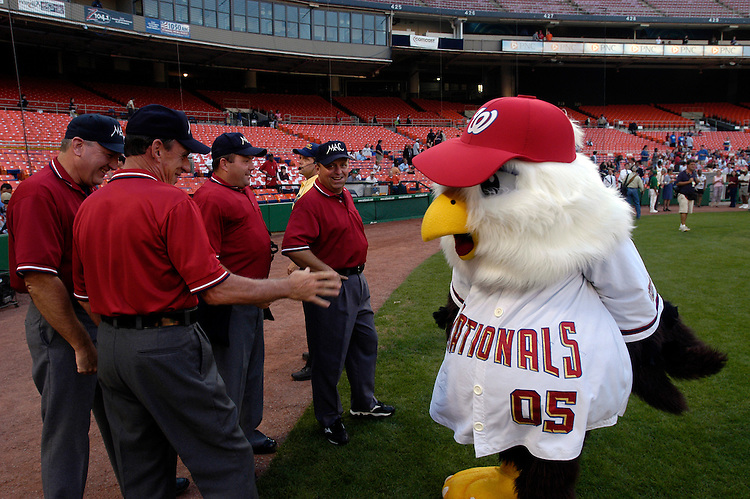 Screech, the Nationals mascot, messes around with the umpires before the 44th Annual Congressional Baseball Game at RFK stadium.