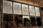 Abandoned El Chupe Bar window
