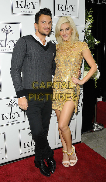 Peter Andre &amp; Ashley Roberts<br /> The KEY Fashion new online fashion boutique launch party, Vanilla, London, England.<br /> September 25th, 2013<br /> full length black jeans denim top sweater jumper hand on hip gold dress<br /> CAP/CAN<br /> &copy;Can Nguyen/Capital Pictures