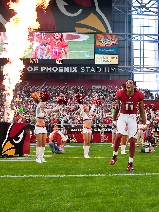 Jan. 18, 2009; Glendale, AZ, USA; Arizona Cardinals wide receiver Larry Fitzgerald is introduced to the crowd prior to the NFC Championship game at University of Phoenix Stadium.