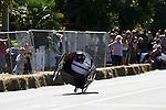 Nervous moment: Ben Webster on two wheels. Robertson's Collingwood Street Trolley Derby, 17 March 2012,  Nelson, New Zealand<br /> Photo: Marc Palmano/shuttersport.co.nz