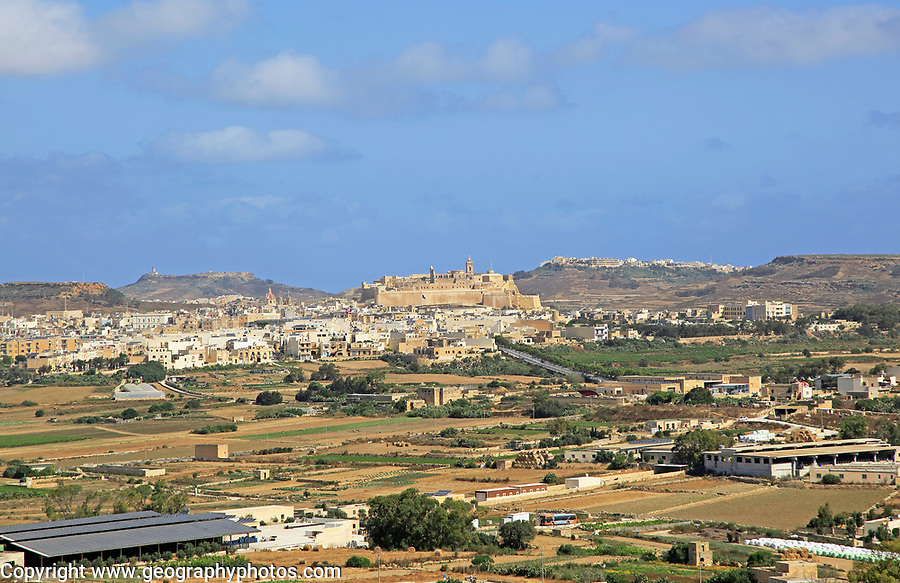 View over fields to citadel castle of Rabat Victoria, island of Gozo, Malta