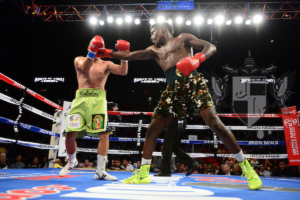 MIAMI, FL - JULY 10: Erickson Lubin (camouflage short) and Noe Bolanos (green short) in the ring fighting at the Iron Mike Judgement Day boxing match at AmericanAirlines Arena on July 10, 2014 in Miami, Florida. Lubin defeated Bolanos by unanimous decision in eight rounds. (Photo by Johnny Louis/jlnphotography.com)