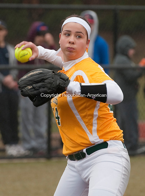 WATERBURY,  CT,  CT-041015JS06- ACTION PERSON- Holy Cross' Sarah Lawton (24) throws to first for the out during their game against Kennedy Friday at Municipal Stadium in Waterbury.  <br /> Jim Shannon Republican-American