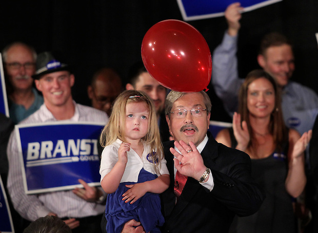 Terry Branstad bats at a balloon with his granddaughter, Mackenzie, 3, after claiming victory in the Republican primary election Tuesday night, June 8, 2010, at the 7 Flags Event Center in Clive.
