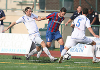 Santiago Fusilier #21 of Crystal Palace Baltimore gets between Adam Braz #3 and Nevio Pizzolitto #5 of the Montreal Impact during an NASL match at Paul Angelo Russo Stadium in Towson, Maryland on August 21 2010. Montreal won 5-0.