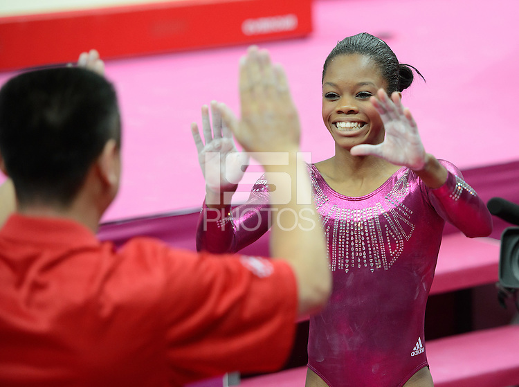 London, England - Thursday, August 2, 2012: USA's Gabrielle Douglas celebrates with her coach Liang Chow after competing in the balance beam to win gold in the women's gymnastics individual all around at the London 2012 Summer, Olympic Games, North Greenwich Arena, London. .