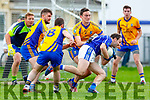 Colm O'Shea Laune Rangersis stopped by Sean Arthurs aand Cormac Johnson Beaufort during the Mid Kerry clash in Killorglin on Sunday