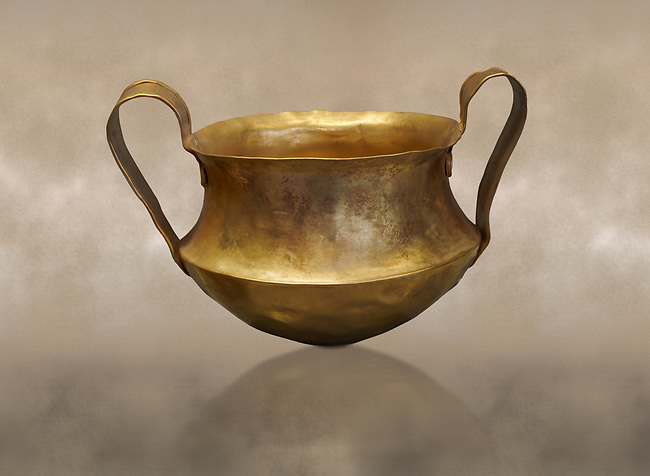 Two handled Mycenaean gold bowl cup from the Kakovatos tholos tomb, Trifylia, Greece. National Archaeological Museum Athens. <br /> <br /> Kakovatos is a significant site of the early Mycenaean period of Greece (c. 16th to 15th century BC) on the west coast of the Peloponnese (Zacharo, Nomos Elis) and became widely known through the excavations of three large tholos tombs by Wilhelm Dörpfeld in 1907–1908.