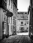 Tradition boutique store sign in a small historic street Rue Pains Benits, historic French architecture of the Old Quebec City. Black and white. Quebec, Canada. Rue des Pains Bénits, Ville de Québec.
