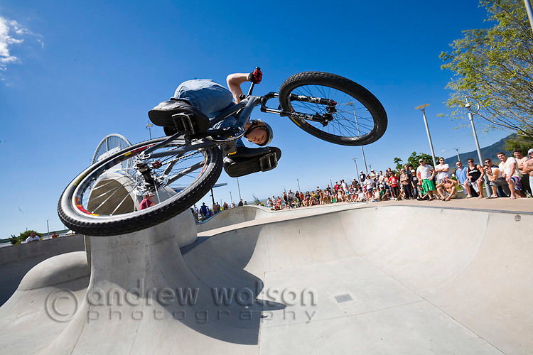 BMX rider performing trick as crowd watches on.  Cairns, Queensland, Australia