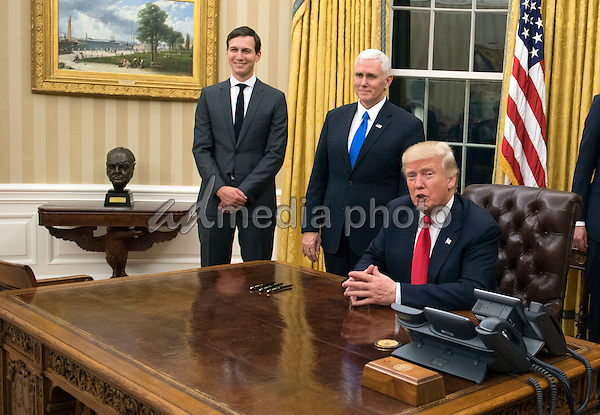 President Donald Trump speaks to the media before signing a confirmation for Defense Secretary James Mattis in the Oval Office at the White House in Washington, D.C. on January 20, 2017. Photo Credit: Kevin Dietsch/CNP/AdMedia