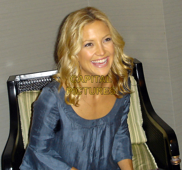 """KATE HUDSON        .Press conference for """"You, Me & Dupree"""" at the Casa Del Mar Hotel, Santa Monica, USA..June 23rd, 2006.Ref: AW.half length sitting blue laughing.www.capitalpictures.com.sales@capitalpictures.com.© Capital Pictures."""