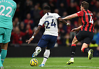 30th November 2019; Tottenham Hotspur Stadium, London, England; English Premier League Football, Tottenham Hotspur versus AFC Bournemouth; Serge Aurier of Tottenham Hotspur clears the ball under pressure  from Dan Gosling of Bournemouth as Spurs hold on for the win - Strictly Editorial Use Only. No use with unauthorized audio, video, data, fixture lists, club/league logos or 'live' services. Online in-match use limited to 120 images, no video emulation. No use in betting, games or single club/league/player publications