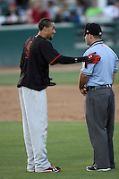 Billy Hamilton #4 of the Bakersfield Blaze talks with umpire Mike Cascioppo after being called out while attempting to steal second base against the Rancho Cucamonga Quakes at The Epicenter on June 21, 2012 in Rancho Cucamonga, California. Bakersfield defeated Rancho Cucamonga 12-2. (Larry Goren/Four Seam Images)