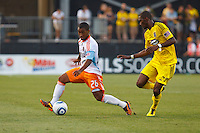 24 JULY 2010:  Corey Ashe of the Houston Dynamo (26) and Shaun Francis of the Columbus Crew (29) during MLS soccer game between Houston Dynamo vs Columbus Crew at Crew Stadium in Columbus, Ohio on July 3, 2010. Columbus defeated the Dynamo 3-0.