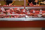 Butchers preparing meat for sale, at a food market in Santa Cruz, Tenerife.