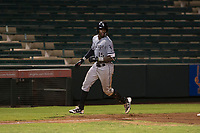 Center fielder Luis Robert (15), on rehab assignment with the AZL White Sox, holds at third base for a triple during an Arizona League game against the AZL Angels at Tempe Diablo Stadium on August 3, 2018 in Tempe, Arizona. The AZL White Sox defeated the AZL Angels 6-4. (Zachary Lucy/Four Seam Images)
