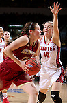 SIOUX FALLS, SD - MARCH 5:  Paige Bradley #22 of Denver drives against Allison Arens #10 of South Dakota during the 2016 Summit League Tournament. (Photo by Dave Eggen/Inertia)