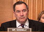 """United States Senator Joe Donnelly (Democrat of Indiana) questions the witnesses during the US Senate Committee on Banking, Housing and Urban Affairs hearing titled """"Implementation of the Economic Growth, Regulatory Relief, and Consumer Protection Act"""" on Capitol Hill in Washington, DC on Tuesday, October 2, 2018.<br /> Credit: Ron Sachs / CNP"""