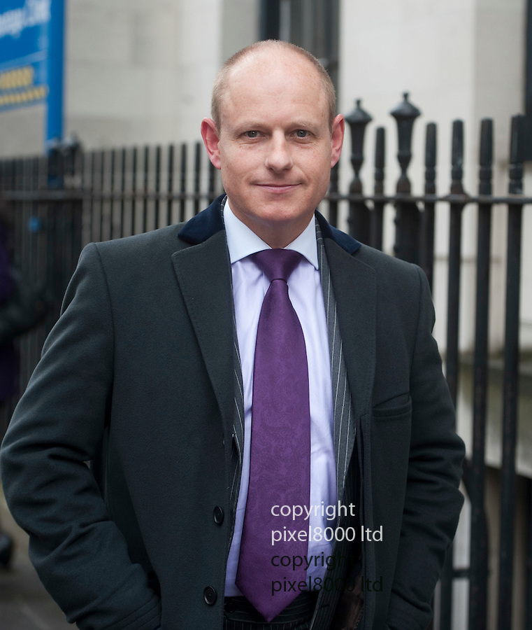 """Gareth Williams MI6 agent holdall death inquest.Westminster Coroners Court 27.4.12..""""Bag expert"""" Peter Faulding gave  evidence on getting in and out of the red North Face bag. demonstration where a police officers tried to reconstruct getting into the bag......Pic by Gavin Rodgers/Pixel 8000 Ltd"""
