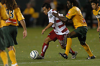 Carlos Ruiz, left, Ugo Ihemelu, right, L.A. Galaxy vs FC Dallas, L.A. won 2-0.
