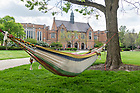 May 15, 2019; A student relaxes in their hammock on South Quad. (Photo by Barbara Johnston/University of Notre Dame)