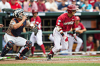 Arkansas Razorbacks second baseman Rick Nomura (1) runs to first base against the Virginia Cavaliers in Game 1 of the NCAA College World Series on June 13, 2015 at TD Ameritrade Park in Omaha, Nebraska. Virginia defeated Arkansas 5-3. (Andrew Woolley/Four Seam Images)