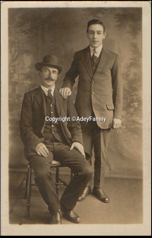 BNPS.co.uk (01202 558833)<br /> Pic: AdeyFamily/BNPS<br /> <br /> Re-Open All Hours...<br /> <br /> Shop owner William Adey with his son William Alexander Adey in the 1920's.<br /> <br /> A greengrocers shop in a Victorian two up two down has been reunited with the family that once owned it after it was painstakingly rebuilt at the Black Country Living Museum in Dudley.<br /> <br /> The turn-of-the-century greengrocers shop has re-opened for business almost a 100 years after it served its first customers - and it is an exact replica of how it used to be.<br /> <br /> Plucky housewife Gertrude Adey transformed her modest front room into a fruit and veg shop in 1916 to earn a few shillings so she could survive while husband William was off fighting in the First World War.<br /> <br /> In 1995 the historic building was demolished to pave the way for a new development in the town centre but 98 years after it first opened the shop is back in business after it was lovingly rebuilt brick by brick.<br /> <br /> The humble shop will only sell produce that was available at the time and any left over fruit and veg will be turned into pickles, chutneys and jams, just like it would have been back in the early 20th century.<br /> <br /> And staff will even be dressed in plain period clothing just as William and Gertrude would have worn. <br /> <br /> The opening of the time-warp shop is the culmination of a project by local historians who rebuilt the shop in the grounds of the Black Country Living open air museum.<br /> <br /> Three generations of the Adey family - William's grandson Jim, 85, great grandson Andrew, 54, and great-great granddaughter Melanie, 22 - officially opened the shop on Saturday.