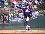 L.A. Dodgers' Kike Hernandez makes a play in a spring training game in Glendale, Ariz., on Saturday, March 19, 2016. <br />