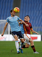 Calcio, Serie A: Roma vs Lazio. Roma, stadio Olimpico, 8 novembre 2015.<br /> Lazio's Senad Lulic, left, and Roma's Alessandro Florenzi fight for the ball during the Italian Serie A football match between Roma and Lazio at Rome's Olympic stadium, 8 November 2015.<br /> UPDATE IMAGES PRESS/Isabella Bonotto