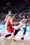 Real Madrid's Luka Doncic and Othello Hunter and Crvena Zvezda Mts Belgrade's Nate Wolters during Turkish Airlines Euroleague match between Real Madrid and Crvena Zvezda Mts Belgrade at Wizink Center in Madrid, Spain. March 10, 2017. (ALTERPHOTOS/BorjaB.Hojas)