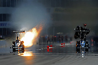 May 5, 2012; Commerce, GA, USA: NHRA top fuel dragster driver Bruce Litton (left) blows an engine during qualifying for the Southern Nationals at Atlanta Dragway. Mandatory Credit: Mark J. Rebilas-