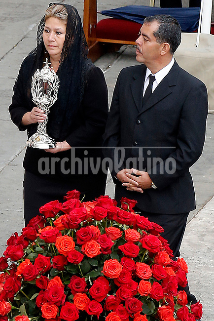 Costa Rican Floribeth Mora Diaz, who claims she was cured of a serious brain condition by a miracle attributed to Pope John Paul II, and her husband Edwin Arce bring the relic during the canonisation mass of Popes John Paul II and John XXIII in St Peter's  Square on April 27, 2014 in Vatican