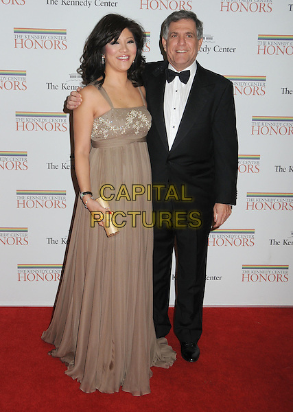 JULIE CHE & LES MOONVES .Gala Dinner honoring the 32nd Kennedy Center Honors held at the State Department, Washington DC, USA, .5th December 2009..full length beige dress brown long maxi black tuxedo bow tie tux gold clutch bag .CAP/ADM/LF.©Laura Farr/Admedia/Capital Pictures