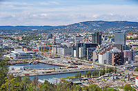 Oslo city centre, view from a hill named Ekebergåsen. In the centre of the picture is the The Barcode Project, a section of the Bjørvika portion of the Fjord City redevelopment on former dock and industrial land in central Oslo. Oslo Opera House is also visible on the left.