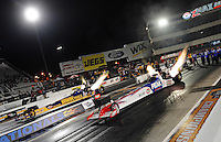 Sept. 17, 2010; Concord, NC, USA; NHRA top fuel dragster driver T.J. Zizzo (right) and Doug Herbert launch off the starting line during qualifying for the O'Reilly Auto Parts NHRA Nationals at zMax Dragway. Mandatory Credit: Mark J. Rebilas/