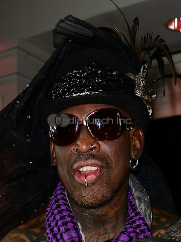 BOCA RATON, FL - OCTOBER 23: Dennis Rodman attends Fright Night by Berman and Berman Law held at the Blue Martini on October 23, 2014 in Boca Raton, Florida. Credit: MPI10 / MediaPunch