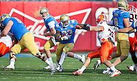 SAN FRANCISCO, CA - December 31, 2011: UCLA running back Derrick Coleman (33) runs through the line against University of Illinois at AT&T Park in San Francisco, California. Final score Illinois wins 20-14.