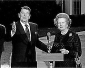 Prime Minister Margaret Thatcher of the United Kingdom, right, is shown with United States President Ronald Reagan following their meeting at the White House in Washington, D.C. on Wednesday, June 23, 1982.  Reagan is photographed as he admonished network reporter Sam Donaldson for asking a question during a photo opportunity, where a small pool of reporters is allowed to observe, but not question.  Thatcher died from a stroke at 87 on Monday, April 8, 2013..Credit: Howard L. Sachs - CNP