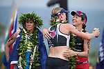 KONA-KAILUA, HI - OCTOBER 11: Daniela Ryf of Switzerland hugs fellow competitor Rachel Joyce of Great Britain at the finish line at the 2014 IRONMAN Triathlon World Championships presented by GoPro on October 11, 2014 in Kailua-Kona, Hawaii. (Photo by Donald Miralle) *** Local Caption ***
