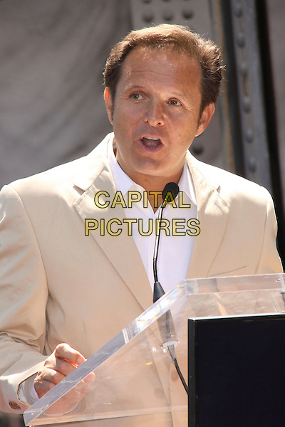 MARK BURNETT .Producer Mark Burnett Honored With the 2,387th Star On The Hollywood Walk Of Fame held On Hollywood Blvd. .Hollywood, California, USA, .8th July 2009..half length beige suit white shirt speaking in stage microphone podium.CAP/ADM/KB.©Kevan Brooks/Admedia/Capital Pictures